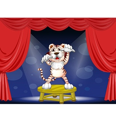 A tiger above a round table vector image vector image