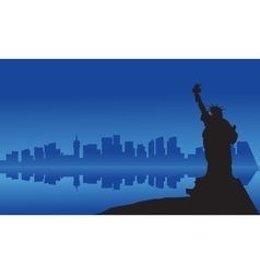 Silhouette of statue liberty from sea vector