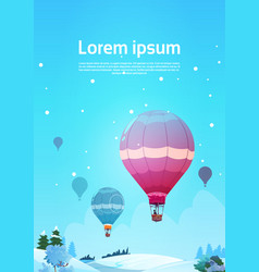 Colorful air balloons flying in sky over winter vector