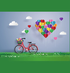 Red bikes parked on the grass with heart shaped vector