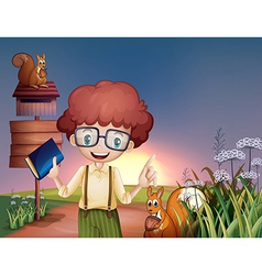 A boy with a book at hill with two squirrels vector