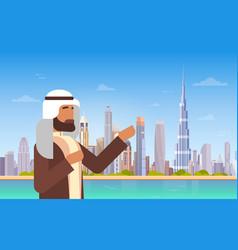 Arab man showing dubai skyline panorama modern vector