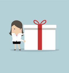 Businesswoman holding a big gift box for christmas vector