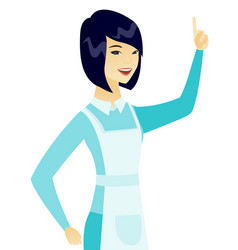 Young asian cleaner pointing her forefinger up vector