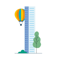 Hot air balloon with city building and tree vector