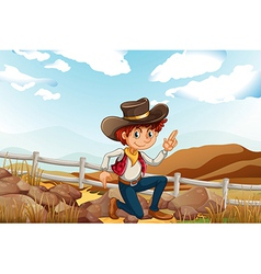 A young explorer at the hilltop near the rocks vector image