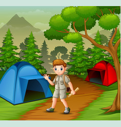 Boy in explorer outfit camping out in nature vector