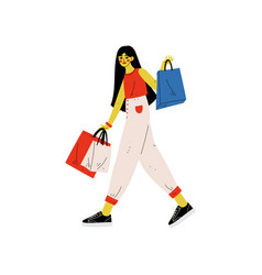 girl in trendy clothes walking with shopping bags vector image