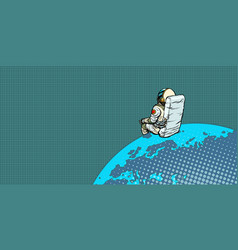 astronaut sits on the planet earth vector image