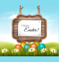 Happy easter background eggs in a green grass and vector