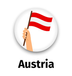 austria flag in hand round icon vector image vector image