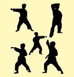 karate kids silhouette vector image