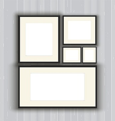 Blank picture frames on a wooden wall background vector image