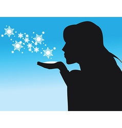 Silhouette of woman blowing snow vector