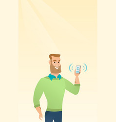 Young caucasian holding ringing mobile phone vector
