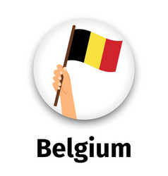 belgium flag in hand round icon vector image vector image