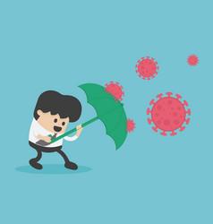 Green umbrella protecting young businessman vector