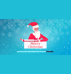 santa claus holding wrapped gift box merry vector image