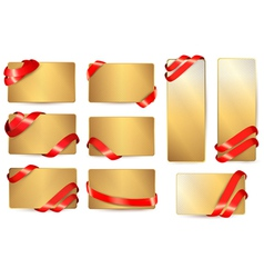Set of gold business cards with red ribbons vector