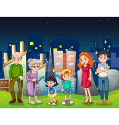 A family at the city standing in front of the tall vector image vector image