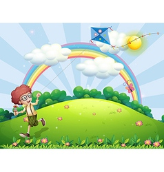 A boy playing with his kite at the hilltop with a vector image