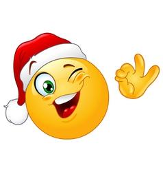 winking emoticon with santa hat vector image