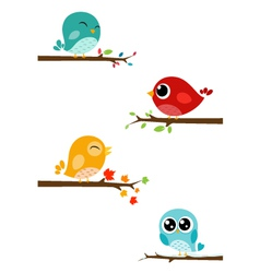 Birds sitting on branches vector