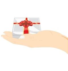 Gift in hand vector image vector image