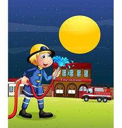 A fireman holding a hose vector image