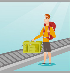 Man picking up suitcase from conveyor belt vector