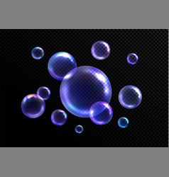 Realistic soap bubbles isolated on black vector