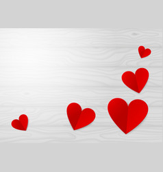 red paper hearts on a light wooden table vector image