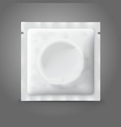 Blank white plastic condom pack isolated on grey vector image