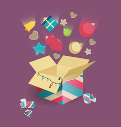 Christmas decorations falling into a box vector