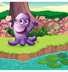 A three-eyed violet monster at the riverbank vector image
