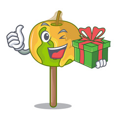 With gift candy apple mascot cartoon vector