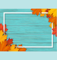 Autumn leaves and frame on old wooden background vector