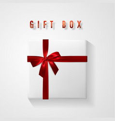 set white gift box with red bow and ribbon top vector image
