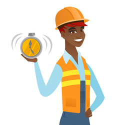 Young african-american builder holding alarm clock vector