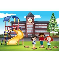 Children standing in front of school vector image