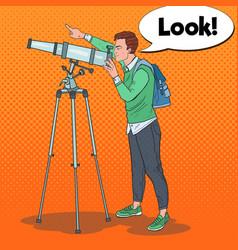 Pop art young man looking through a telescope vector