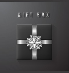 black gift box with white silver bow and ribbon vector image