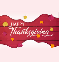 happy thanksgiving text with leaves over red wood vector image