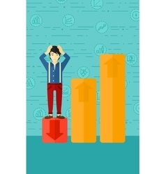 Businessman standing on low graph vector image