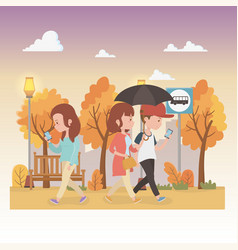 Young people with umbrella walking in park vector