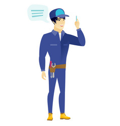 Young asian mechanic with speech bubble vector
