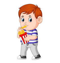 young boy eating french fries vector image
