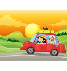A girl and a boy riding in a red car vector
