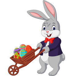 Cartoon rabbit pushing cart full of easter eggs vector