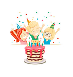 children at birthday party look at the cake vector image